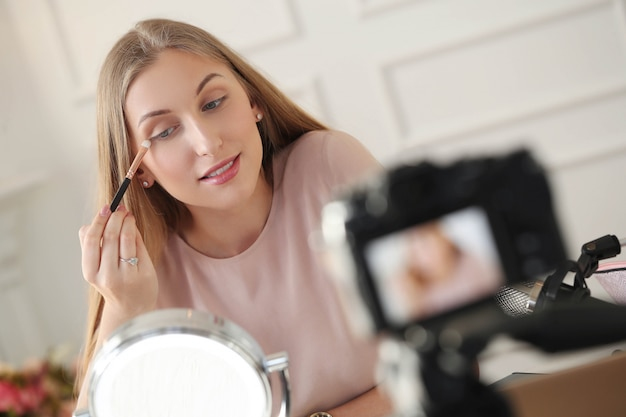 Beauty vlogger. young woman recording a makeup tutorial