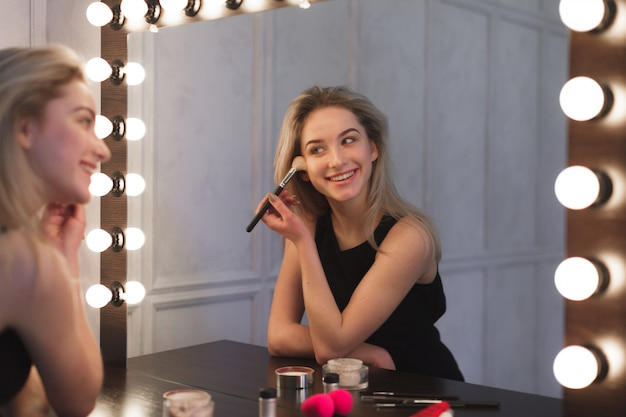 Beauty woman applying makeup