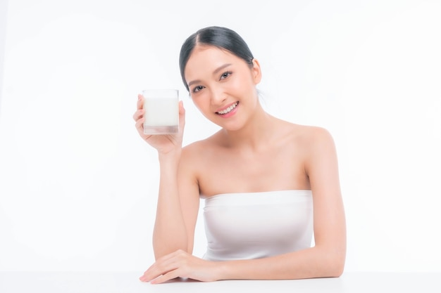 Beauty woman asian cute girl feel happy drinking milk for good health in the morning on white background - lifestyle beauty woman concept