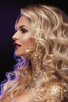 Beauty woman ,  blond  hair , professional make-up , gold color.