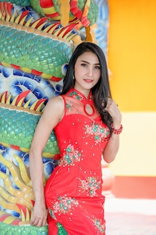 Beauty woman and hold shopping bags in chinese new year