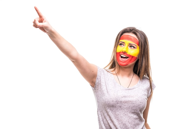 Beauty woman supporter fan of spain national team painted flag face get happy victory screaming pointed hand. fans emotions.