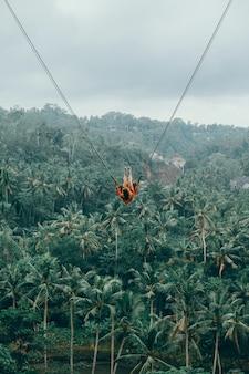 Beauty woman on swing, bali nature, happy face, jungle