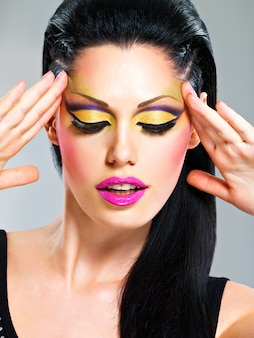 Beauty  woman with fashion makeup on  face poses