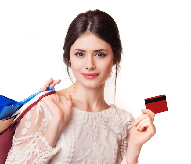 Beauty woman with shopping bags isolated