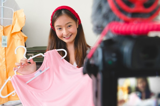 Beauty young asian vlogger blogger interview with professional dslr digital camera