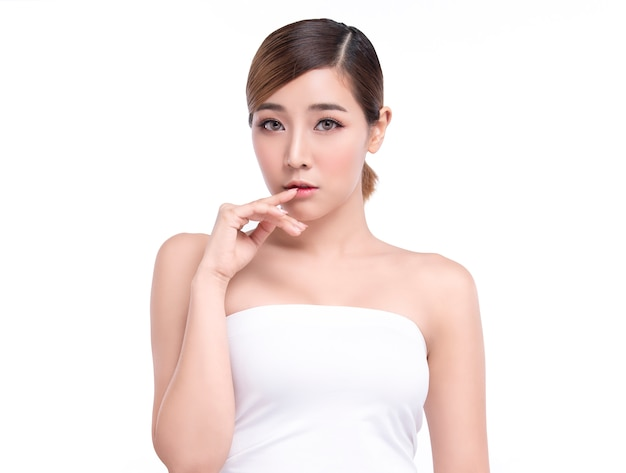 Beauty young asian woman with perfect facial skin. gestures for advertisement treatment spa and cosmetology.