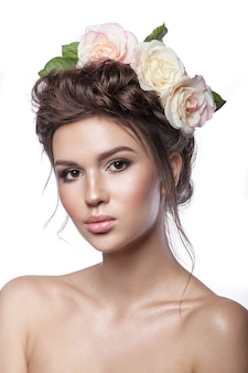 Beauty young girl, clean skin, beautiful make-up, hairstyle braids and rose flowers in hair.