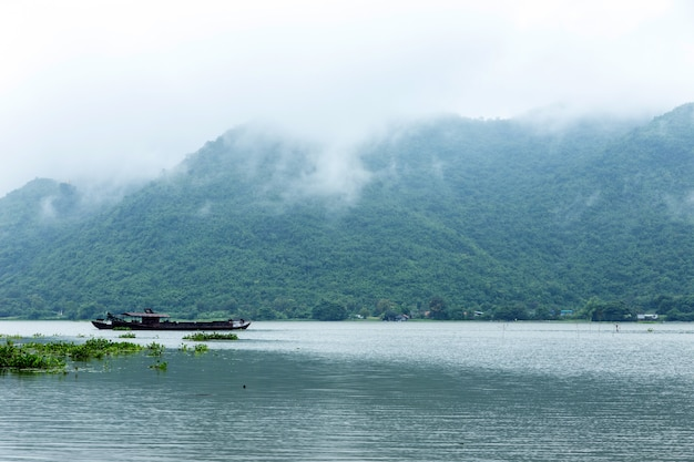 Beautyful landscape water lake with high hill mountain
