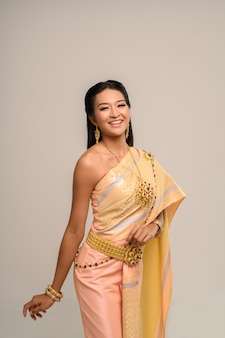 Beautyful thai woman wearing thai dress and smile