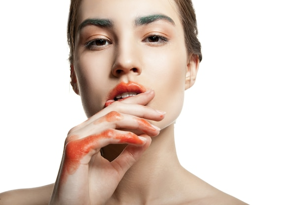 Beautyful woman with creative make-up isolated
