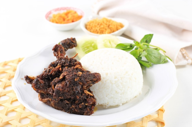 Bebek madura, traditional fried duck with maduranese typically sauce. usually served with raw vegetable and spicy sambal. popular as penyetan