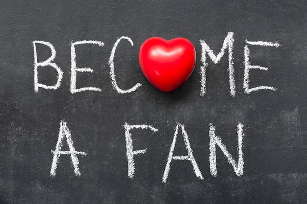 Become a fan phrase handwritten on chalkboard with heart symbol instead of o