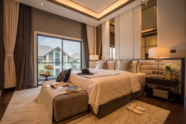 Bed and nightstand in modern bedroom and equipment for a comfortable and restful experience.