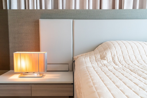 Bed with bedspread and lamp