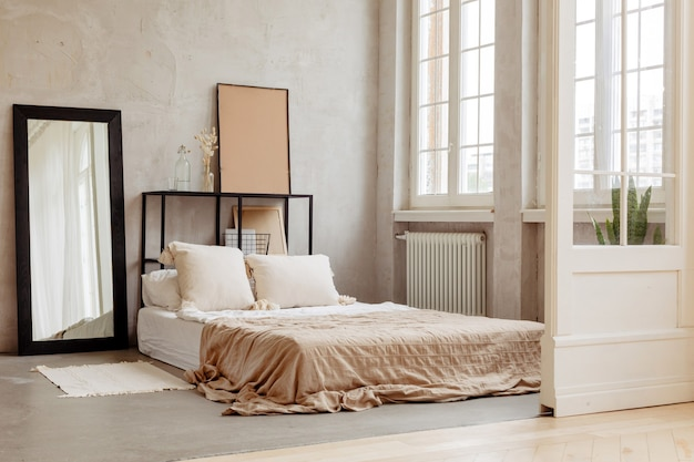 Bed with pillows and beautiful linens of warm colors