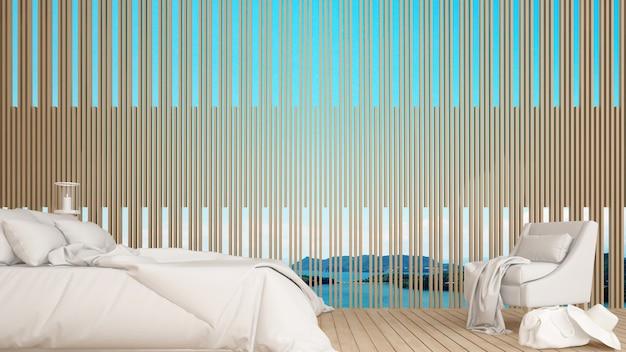 ホテルまたはリゾートの海の景色を望むベッドルームとリビングエリア