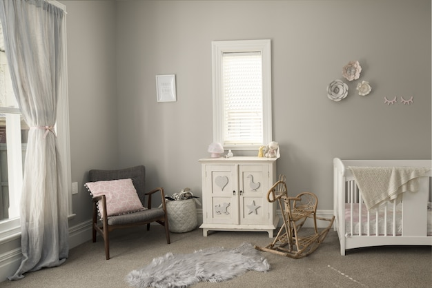 Bedroom of a baby with light-colored furniture and walls