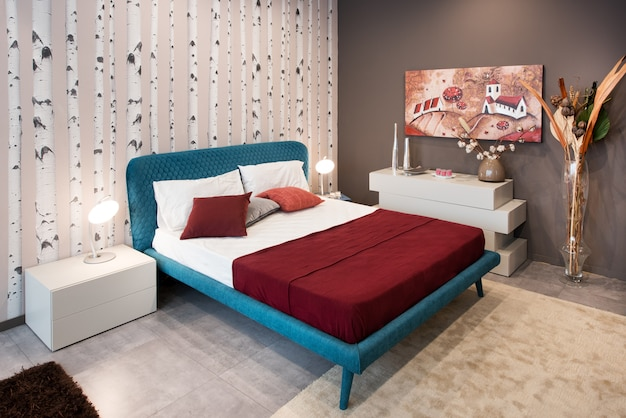 Bedroom design concept with blue bed