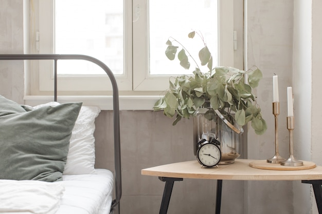 Bedroom interior clock plant pot on wooden table