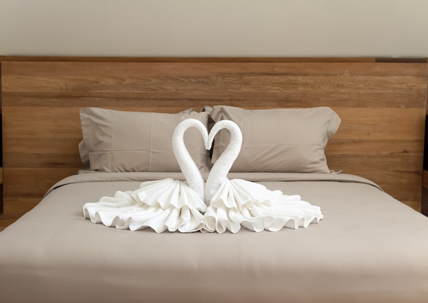 Bedroom interior design with swans from the towel decoration on bed