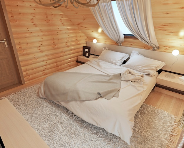 Bedroom interior in a log on the attic floor with a roof window