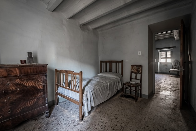 Bedroom of an old house with rustic furniture