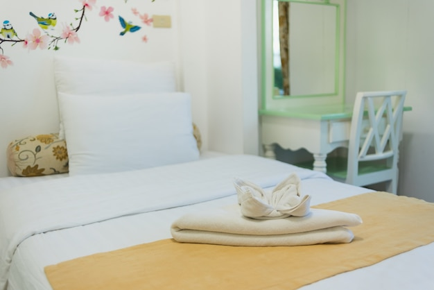 Bedroom in soft light colors. big comfortable single bed in elegant classic bedroom