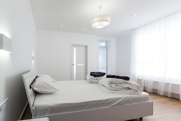 Bedroom with a big white bed