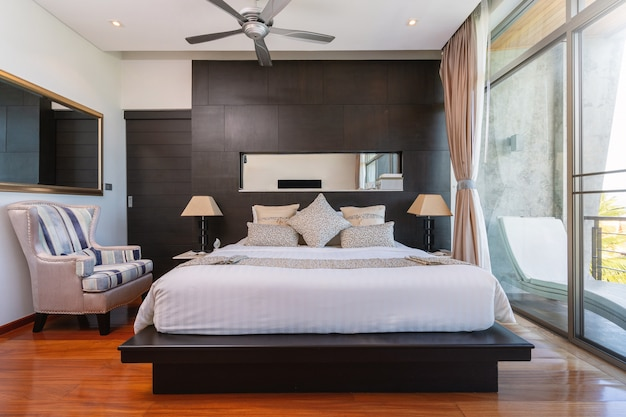 Bedroom with ceiling fan of pool villa, house, home, condo and apartment