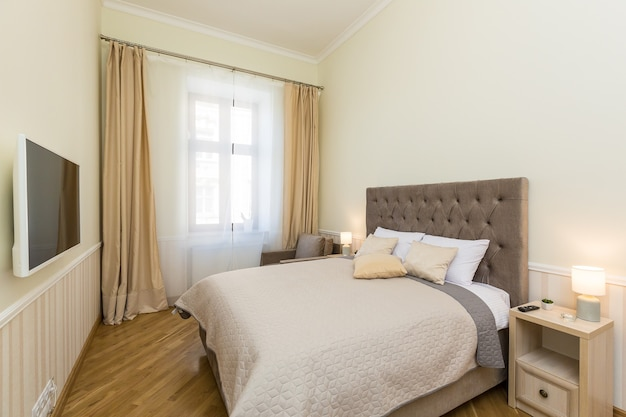 Bedroom with a large bed, in light colors