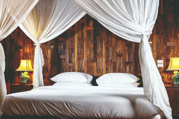 Premium Photo Bedroom With White Baldachin On A Bed In A Wooden Interior At Hotel