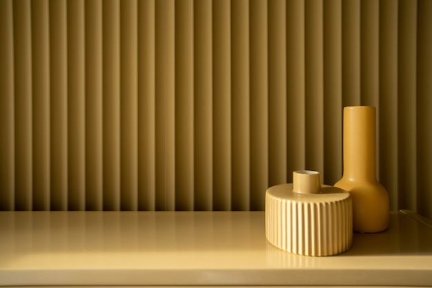 Bedroom working corner decorated yellow ceramic vase on mustard color corrugated wall