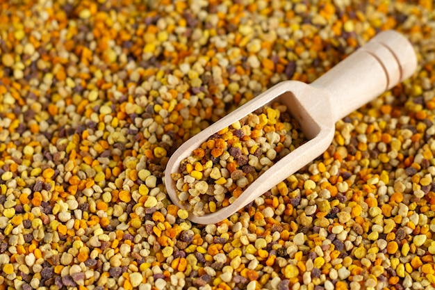 Bee pollen and wooden scoop close-up