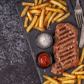 Beef barbecue steak with french fries