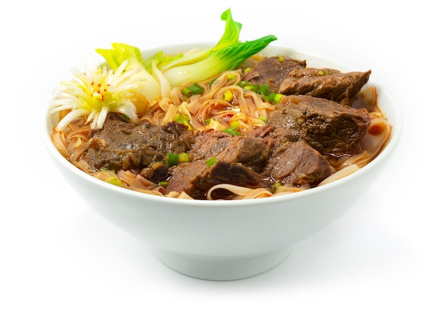 Beef braised noodles soup taiwanese style decoration with vegetable sideview