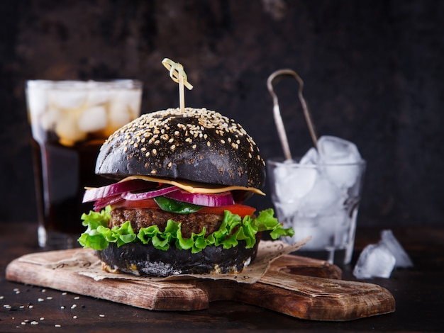 Beef burger with a black bun,with lettuce and mayonnaise
