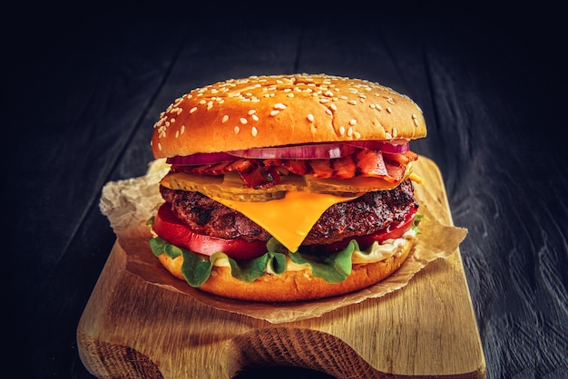 Beef burger with melted cheese and bacon