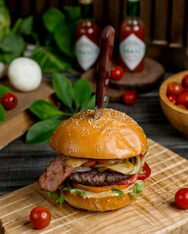 Beef burger with mushroom bell pepper tomato lettuce and caramelized onion