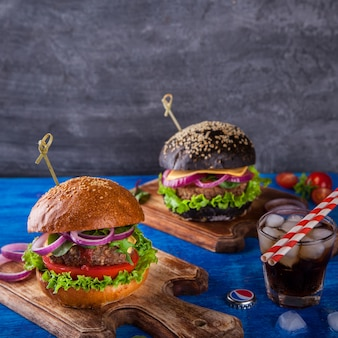 Beef burger with white and black bun