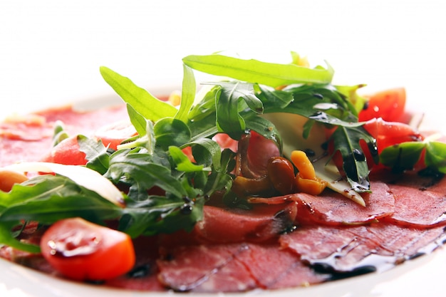 Beef carpaccio served with ruccola