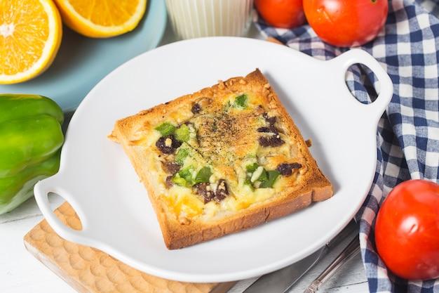 Beef cheese toast,breakfast, oranges