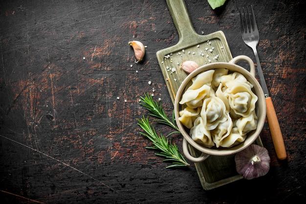 Beef dumplings in the bowl. on dark rustic