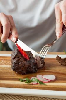 Beef fillet mignon medium roasting on a wooden board