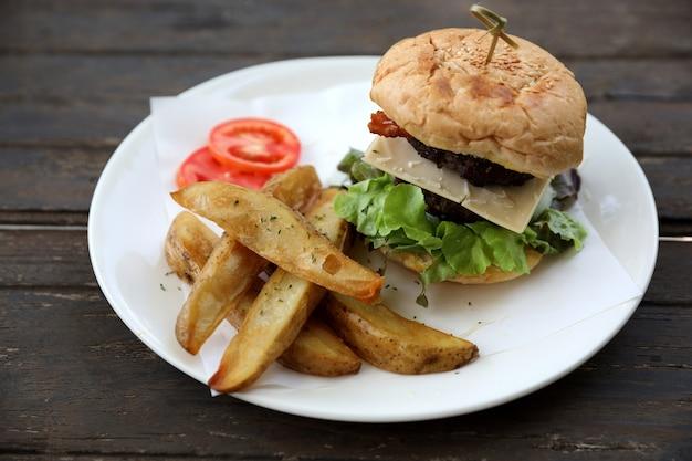 Beef hamburger on wood