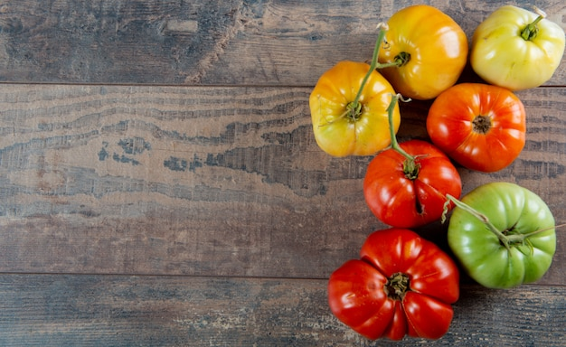 Beef heart tomatoes in the basket on wooden background