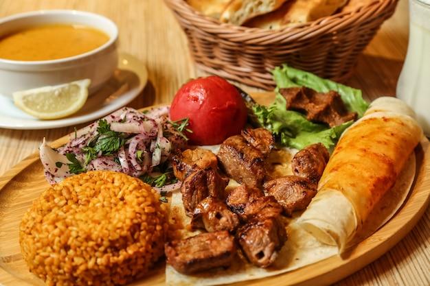 Beef kebab lavash onion greens bulgur