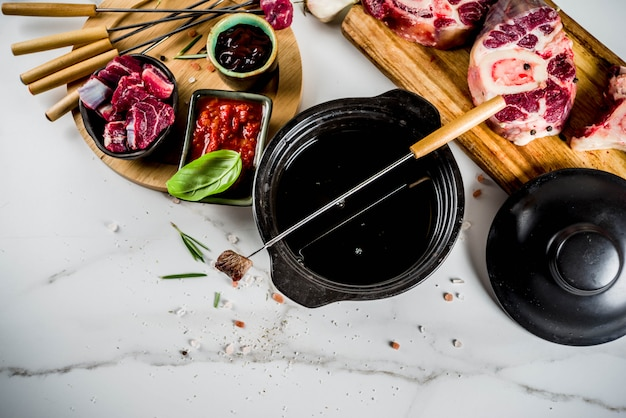 Beef meat fondue, with different sauces, top view copy space