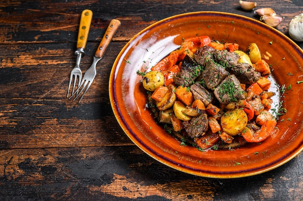 Beef meat stewed with vegetables on a plate