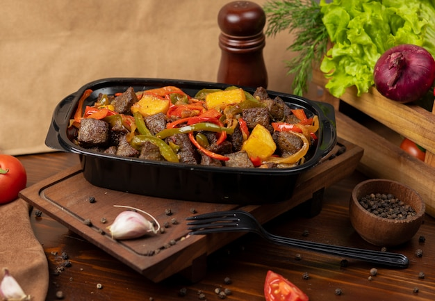 Beef pan baebacue, bbq with grilled potatoes and bell peppers
